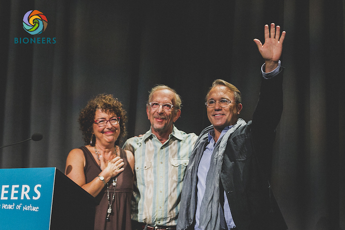 Bioneers founders Nina Simons and Kenny Ausubel with Executive Director Joshua Fouts at Bioneers 2015. Photo by Josué Rivas.
