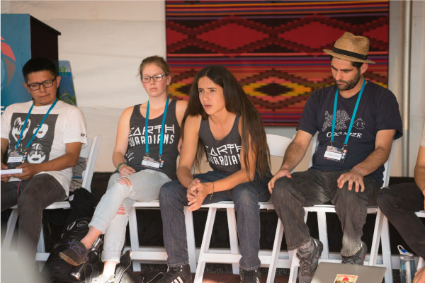 Leading youth activist Xiuhtezcatl Martinez facilitating a national organizing session at Bioneers 2015. Photo by Michelle Grambeau.