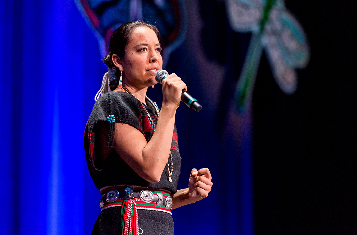 Lyla June speaking at the 2018 Bioneers conference. Photo by Nikki Ritcher